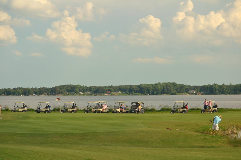 Line up of golf carts along the course